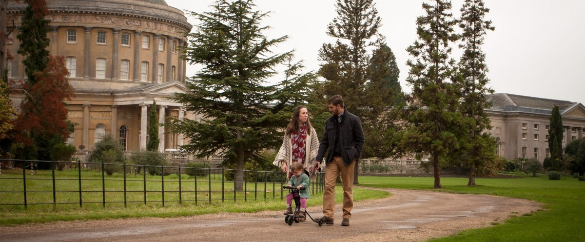A young family strolls The Ickworth hotel grounds.