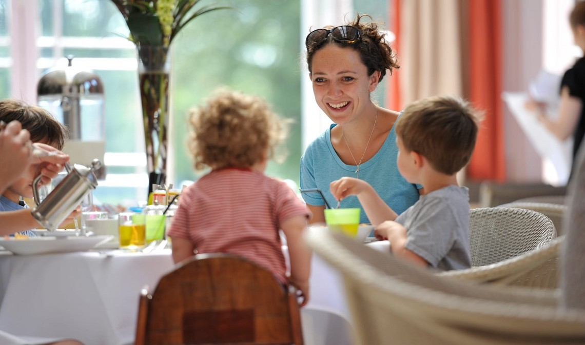 Mother and children eating out in Suffolk at The Ickworth
