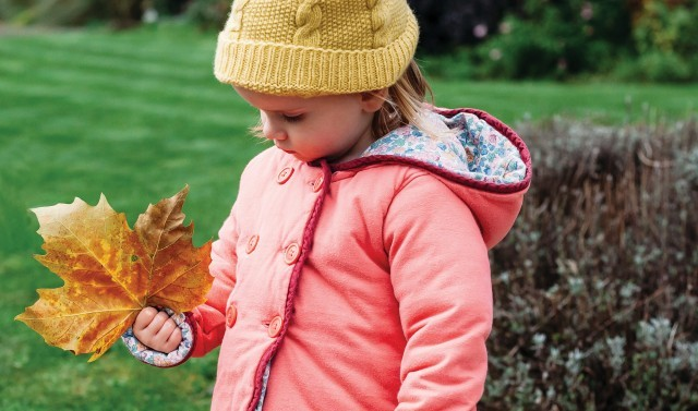 Girl holding an autumn leaf
