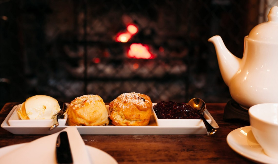 Afternoon tea by the fireplace at The Ickworth luxury family hotel in Suffolk