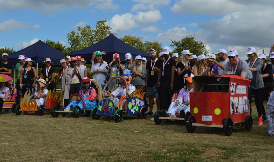 Teams line up to start a soapbox derby.
