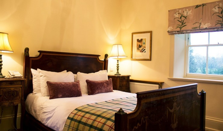 Bed in a two-bedroom suite at The Lodge in Suffolk
