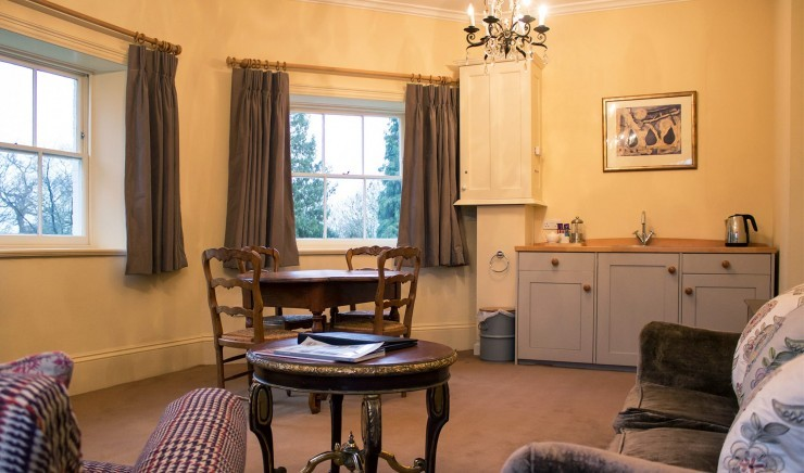Dining area and kitchenette in a suite at the Ickworth Lodge