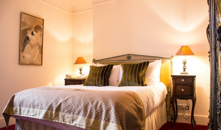 Double bed in a classic bedroom at The Ickworth