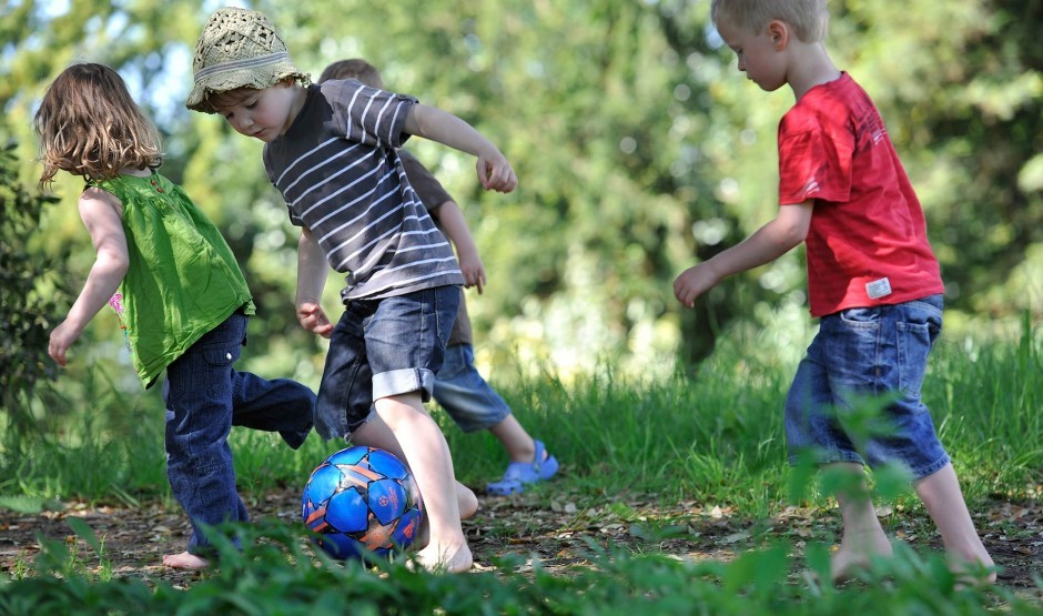 Children playing football on the Ickworth estate